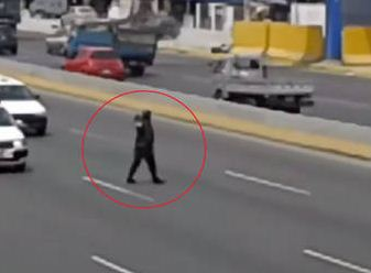 Watch As This Police Officer Walks Into Highway Traffic To Save A Lost Pup