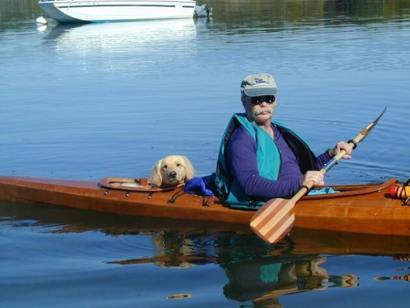Man Creates Special Kayak to Take Dogs on Adventures
