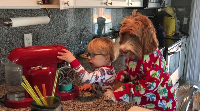 The boy and dog just woke up, and their morning routine will put a smile on your face