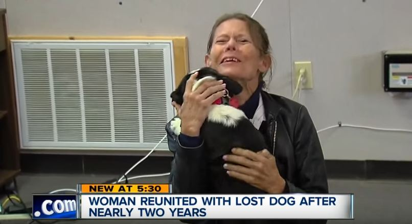 She hadn't seen her dog in 2 years when he comes running around the corner