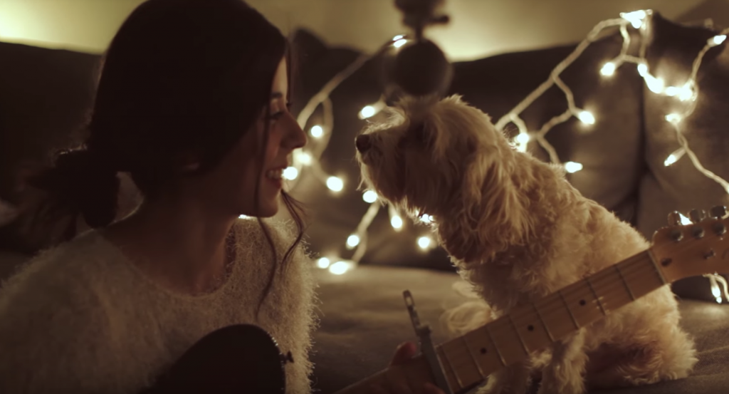 Woman Serenades Her Dog With A Beautiful Christmas Tune