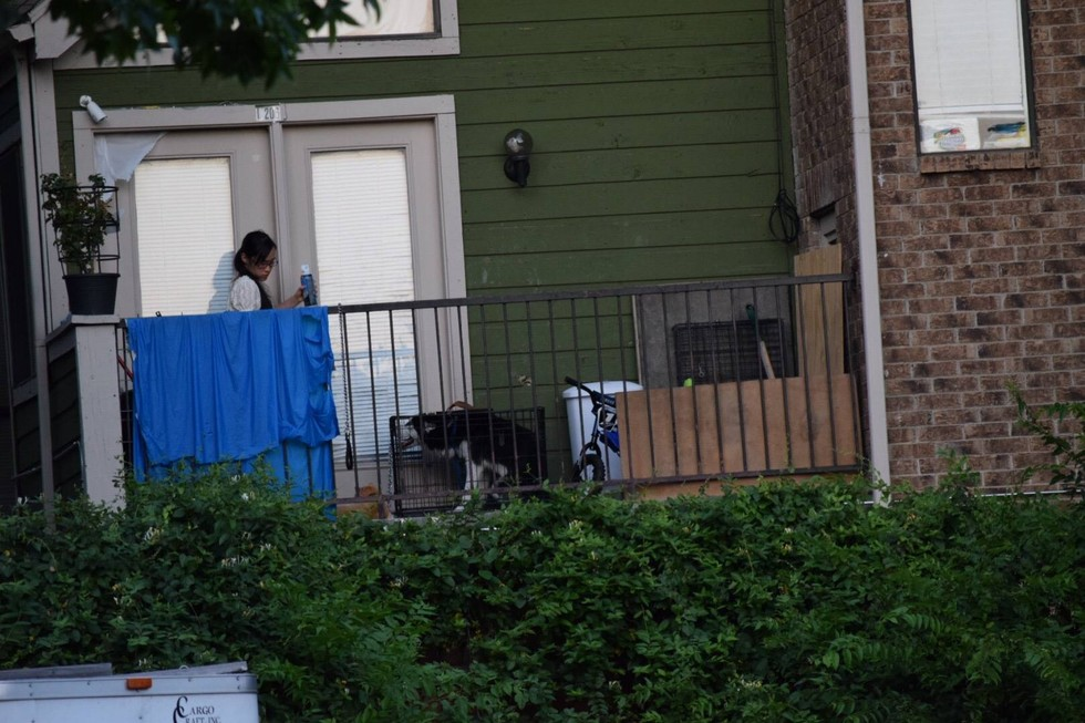 Woman Sees Muzzled-Up Husky On Neighbor's Balcony In Small Crate