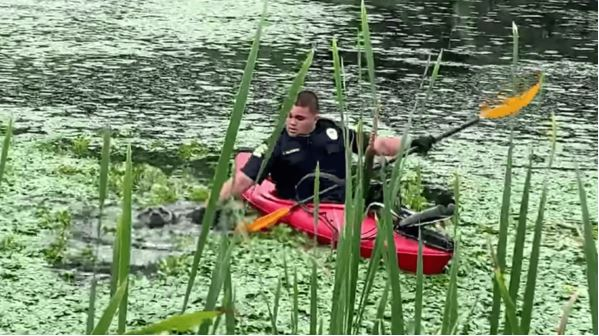 Officers Use Kayak To Rescue Dog From Muddy Pond