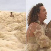 Woman Rescues Dog After It Disappears Under The Heavy Sea Foam